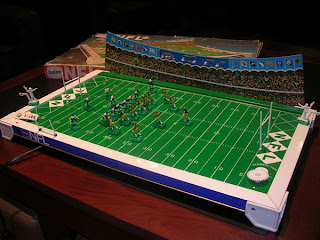 Electric Football Football Figures http://www.knuckleheadhumor.com/2009/12/ghost-of-christmas-presents.html