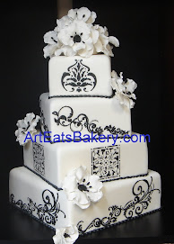 Four tier square black and white wedding cake