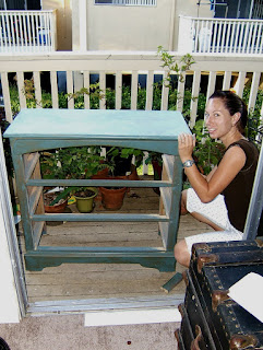 Molly on the balcony sanding her dresser