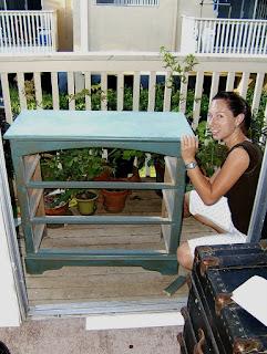 Molly on the balcony sanding her dresser