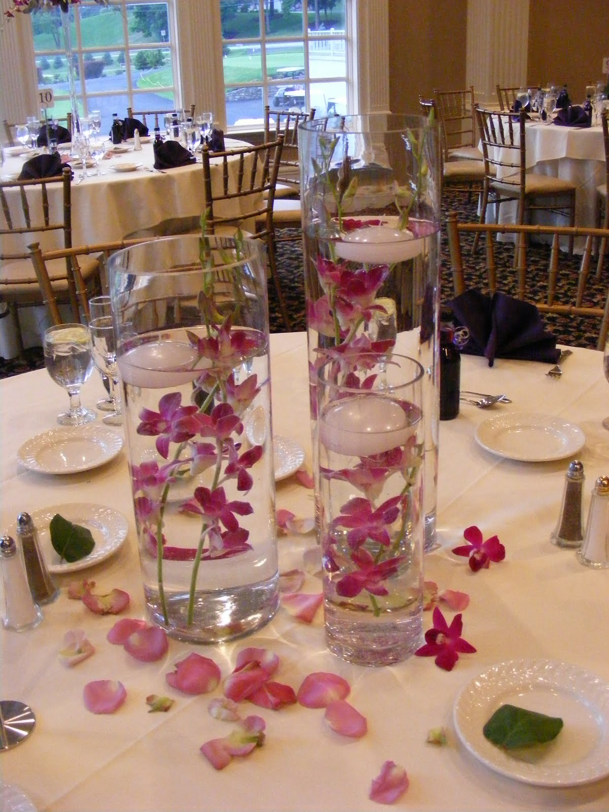 The Second Of The Three Centerpieces Was A Low Mounded Arrangement Of