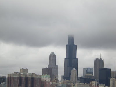 There is the Chicago skyline with the Sears tower 39s very top in clouds