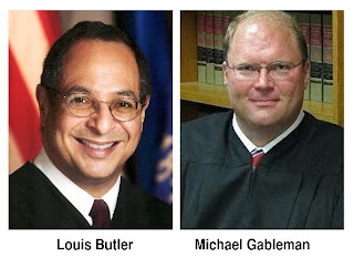 Defeated Supreme Court Justice Louis Butler and newly elected Justice Michael Gableman