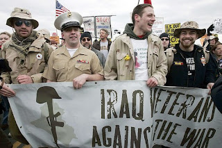 Marine Corporal Cloy Richards, second left, whose mother Tina Richards made national headlines after she had a confrontation with Rep. David Obey (D-WI) questioning Obey's effort on stopping the war in Iraq, marches along with other anti-war activists towards the Pentagon.(Alex Wong / Getty Images)Mar 17, 2007