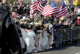 Counter protesters gesture towards the anti-war marchers.(Brendan Smialowski / Getty Images)Mar 17, 2007