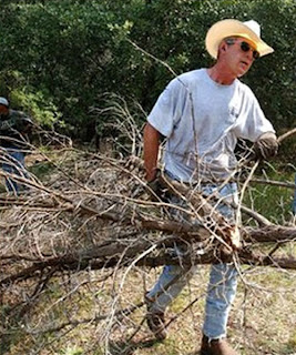 Bush clearing brush at his ranch