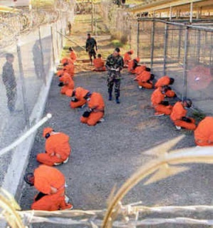 "Guantanamo prisoners being ""processed"""