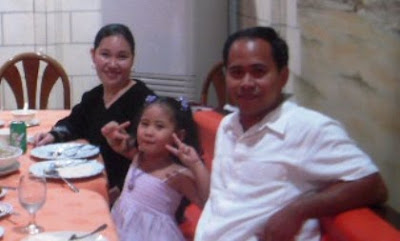 Lark Michael B. Colegado with wife and kid