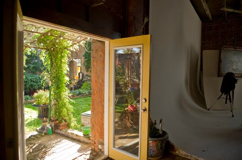 DOOR FROM INTERIOR GOING OUT TO COURTYARD