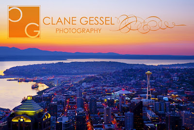 Downtown Seattle as viewed from the Columbia Center Members club on the 75th floor.  This sunset view of downtown Seattle and Elliot Bay shows the Space Needle and the beautiful Puget Sound.  View from the Digital Photographer's Workshop in Seattle by Clane Gessel.