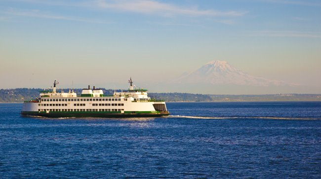 Ferry boat and mount rainier in seattle, wa