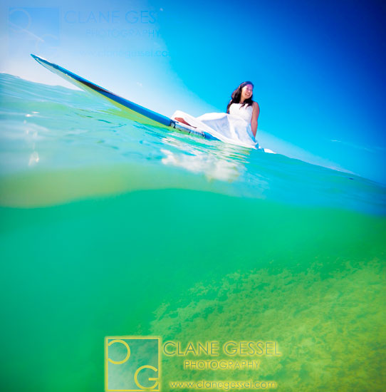 surfing wedding photography surfing in her wedding dress oahu north shore