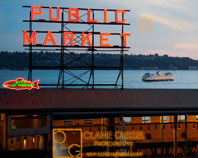 public market center sign pike place market sign with a ferry and sunset