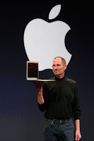 Apple CEO Steve JObs Holding MacBook Air Laptop