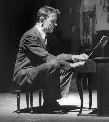 John Cage playing the toy piano