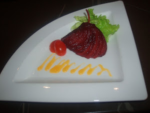 RED WINE PEAR WITH SPICED MANGO COULIS