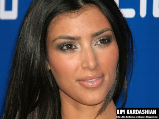 Kim Kardashian Blue background wallpaper