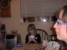 katya playing a card game w/the girls