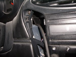 porsche rear spoiler switch install on center console fuse box cover remove 4 screws that hold the fuse box carpet trim and pull out the trim disconnect the connector behind the spoiler rocker switch