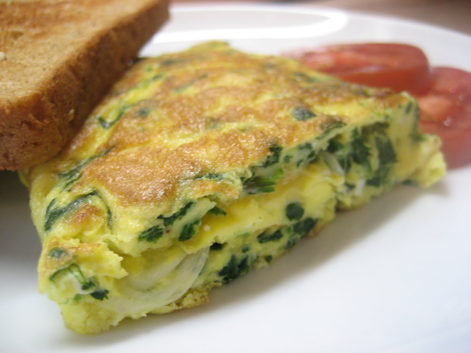 Spinach omelet, sharp cheddar. I like to do an omelet Pam Anderson's ...