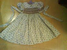 gown with ribbon kat belakang