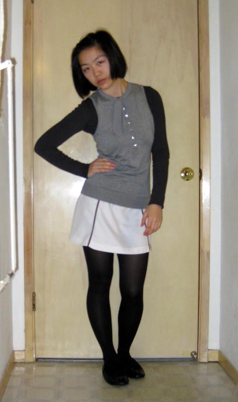 gray tie-neck esprit sweater, white miniskirt