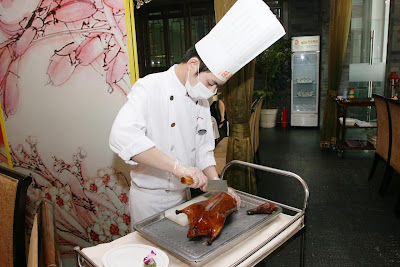 Peking Duck being carved at Quanjude Beijing