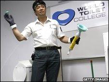 "Japanese ""Toilet professor"" Atsuhiro Katsumata talks to a class of toilet cleaners in Singapore (file photo)"