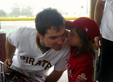 Chloe kisses Andy LaRoche at a Miracle League Game