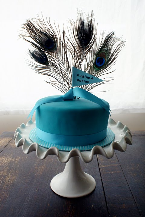 While cruising around I found Coco Cupcake 39s Peacock themed wedding cake on