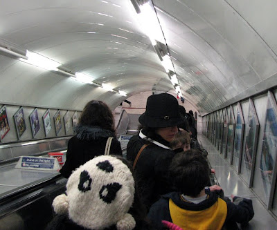 Giant Panda Hat in London Underground