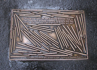 A bronze plaque on a sidewalk in New York