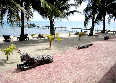 Carved wood jaguar and alligator, Belize