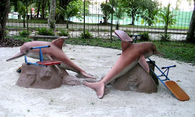 Botos, or Amazon River Dolphins in a hotel play yard, Manaus, Brazil