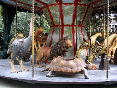 Extinct Atlas, Barbary, or Nubian lion and Extinct Horned Turtle on the Dodo Carousel, Paris, France