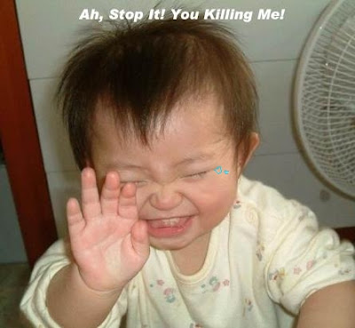 Funny Pictures: A Can't Stop Laughing Baby