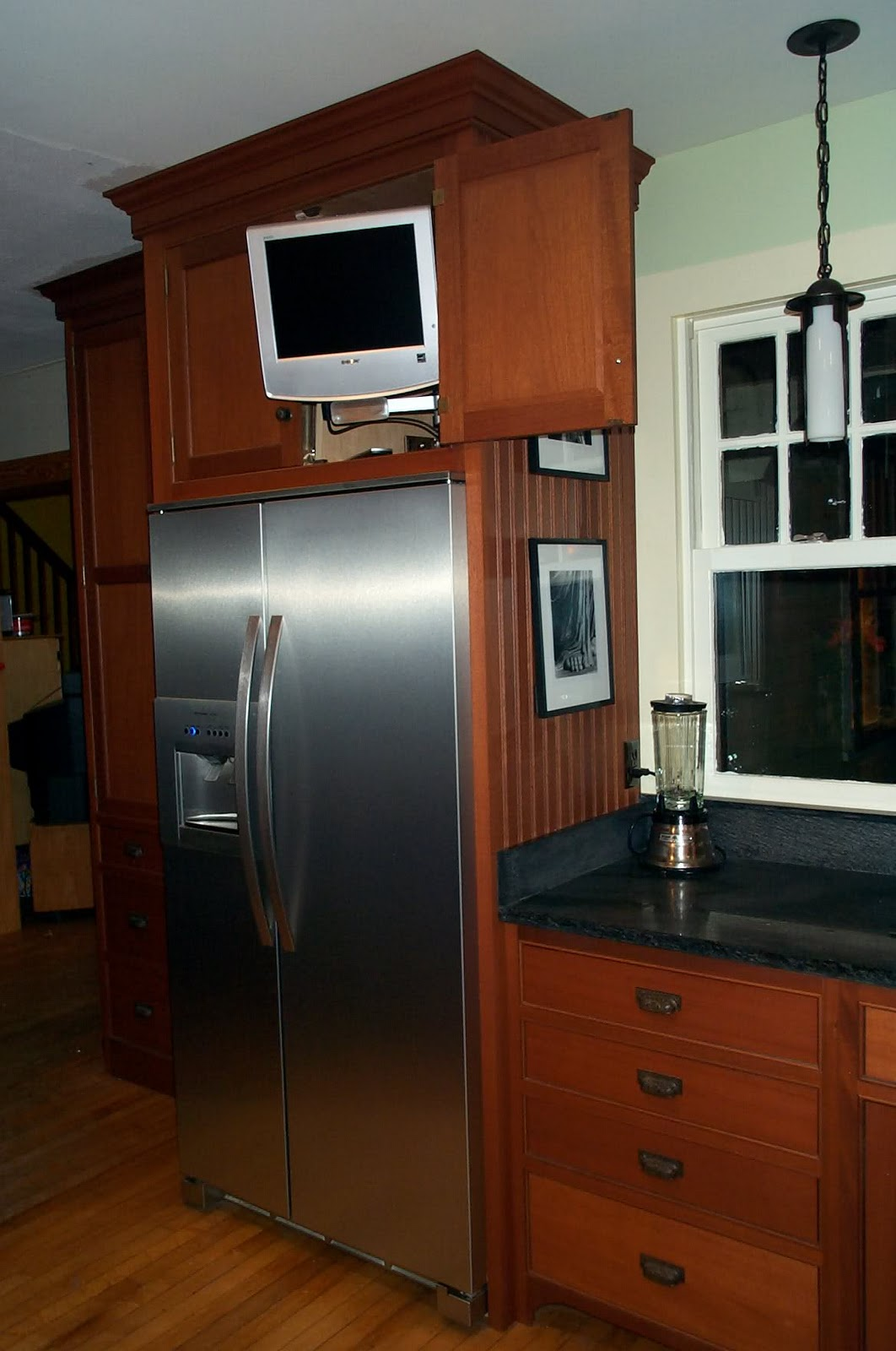 In my hummel opinion cabinets over the refrigerator for Television in the kitchen ideas