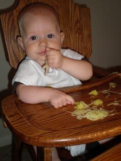Baby eating spaghetti squash
