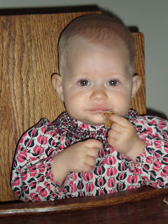 baby eating pancake