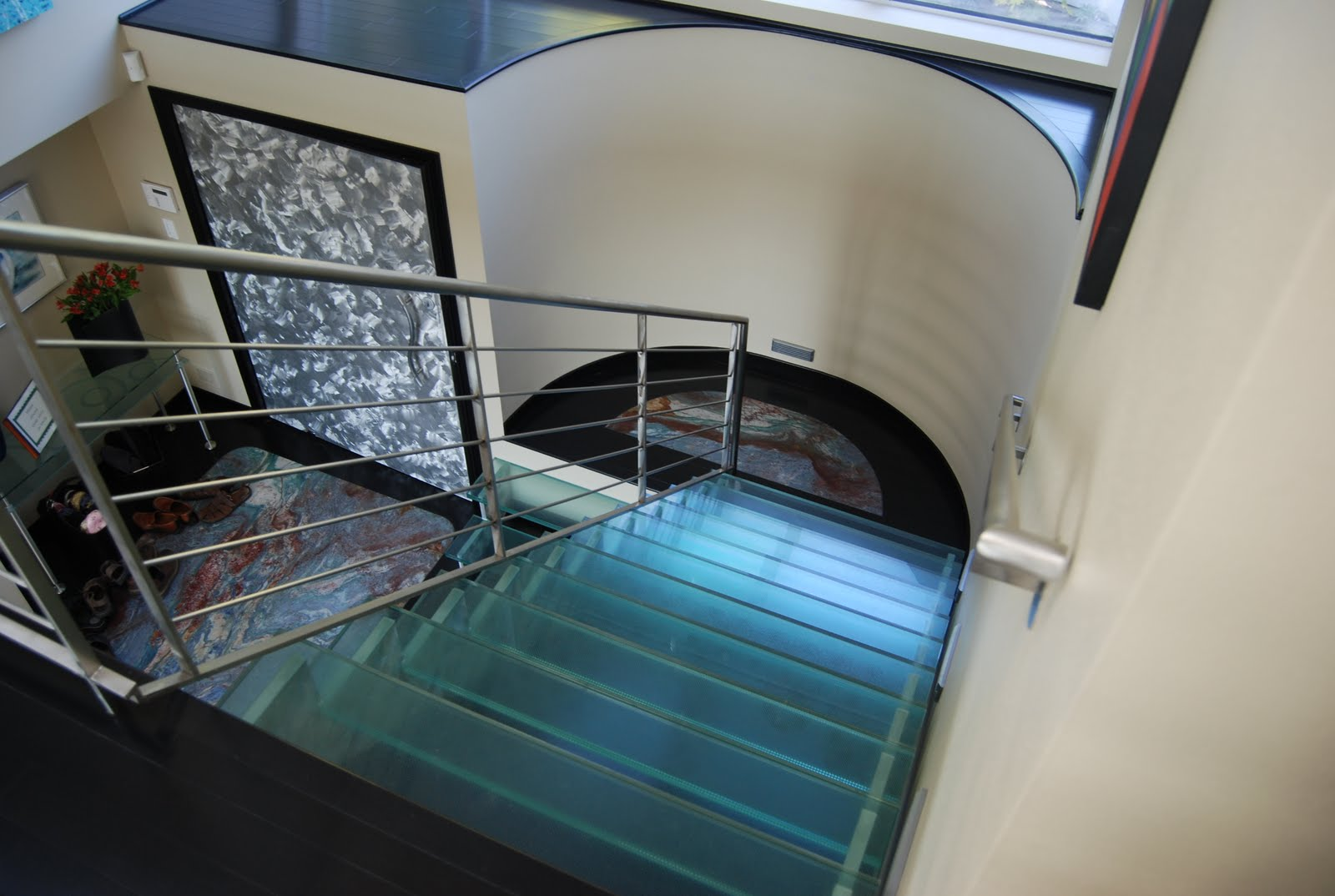 Air as you step off the second floor and onto the glass stairs below