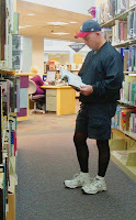 Steve at the library in black opaque tights