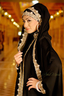 woman wearing a black abaya with golden trim 