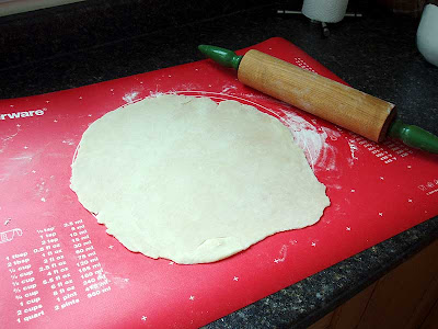 Here I'm using my favourite rolling pin, her name is Mrs. Godkin, to roll out the dough.