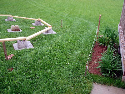 Getting this gap the right size took some time. We had planned to attach the gazebo directly to the existing deck which would have meant that it would be closer. Now that the gazebo is free-standing we need to be able to drive the lawn tractor through this space.