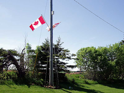 The flag of Canada flying proudly at our house on the Witch's Island.