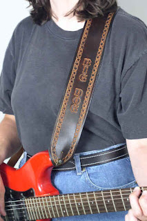how to wear a guitar strap