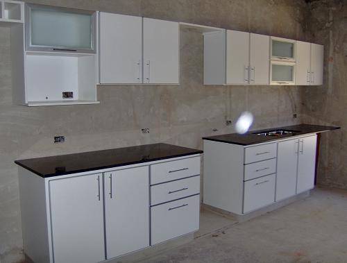 Carpintería en General.: Mueble de cocina en melamina blanca con ...