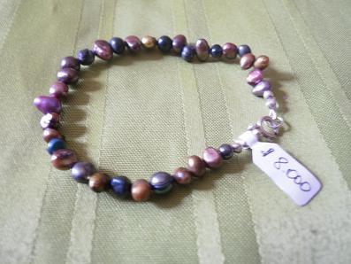 Aros de plata con perlas de río. $6.500