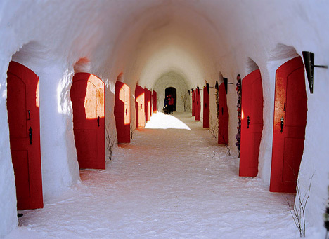 red doors in ice inside a snow castle in Finland