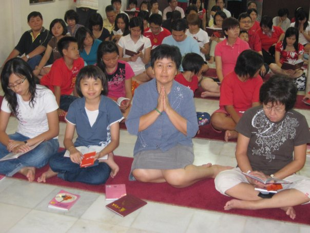 Another group of devotees in the shrine hall